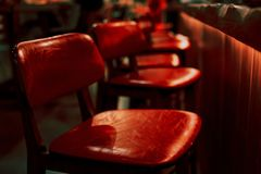 Red bar stool in a restaurant royalty free stock images