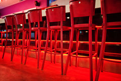 Red bar stools at diode color light. Red bar stools at diode color light Stock Photography
