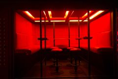 Red bar stools at diode color light.  Royalty Free Stock Photo