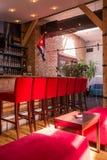Red bar stools in nightclub Stock Photos