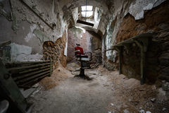 Red barber chair in a jail cell. A creepy old barber chair in Eastern State Penitentiary, Philadelphia Royalty Free Stock Image