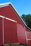 Red Barn. A bright red barn from an Iowa farm set against a bright blue sky Royalty Free Stock Image