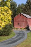 Red Barn. Against Autumn Foliage Stock Photos
