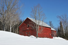 Red Barn. Bright red barn in the snow near Errol, New Hampshire stock images