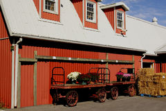 Red barn. With carriage and hay out front Stock Photography