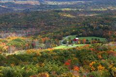 Red Barn. Fall foliage vista with red barn in the distance Stock Photo