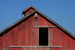 Red Barn. Door open on a red barn end with blue sky background stock photography