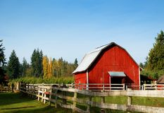 Red Barn. On wooded acre Stock Photo