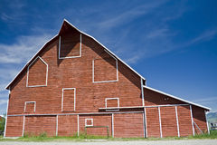 Red Barn. A large red barn against a blue sky Royalty Free Stock Image
