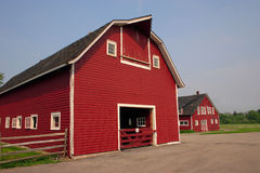 Red Barn. Old red barn and out building on a very old farm stock image