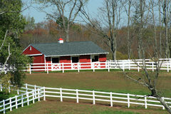 Red Barn And White Fence Stock Image