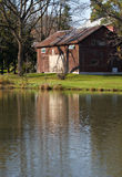 Red barn in autumn reflected in peaceful pond Royalty Free Stock Photography