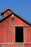 Red Barn with Blue Sky. An aged red barn with blue sky background royalty free stock images