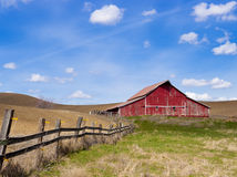 Red barn and blue sky. Stock Photos