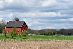Red Barn and Brooding Sky. Bright red barn in Essex, Massachusetts, against a sky full of sullen looking clouds stock images