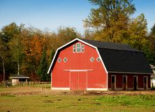 Red Barn in the country. Red Barn on wooded acre Stock Photography