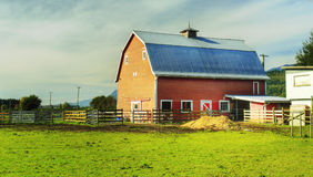 Red Barn Country Farm. Farm scene with a red barn shot in HDR Royalty Free Stock Image