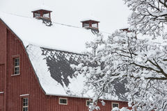 Red barn covered in snow Stock Photos
