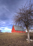 Red barn by a dirt field. Royalty Free Stock Image