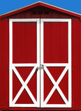 Red Barn Door. At a beautiful blue skied day royalty free stock photography