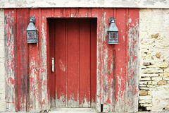 Red Barn Door with Lanterns Royalty Free Stock Photo