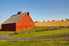 Red Barn and drive in the country Royalty Free Stock Photography