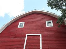 Red barn face. Against blue sky Royalty Free Stock Photo