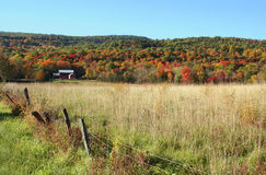 Red Barn, Fall Foliage. And mountains in New England Countryside Royalty Free Stock Photos