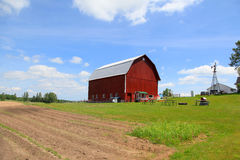Red barn and farm landscape Royalty Free Stock Photography