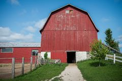 Red barn at a farm in Wisconsin. Red barn at the farm in Wisconsin with a bright blue sky Stock Photography