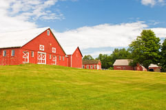 Red barn and farmyard. Rural Vermont farm with a red barn Stock Photos