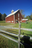 Red barn with fence on Scenic Route 100, VT Stock Images
