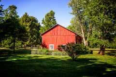 Red Barn with Fenced in Garden Royalty Free Stock Images