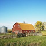 Red barn in field. Royalty Free Stock Images