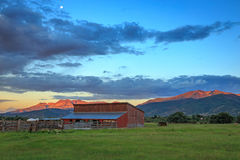 Red barn and field landscape in the Wasatch Mountains, Utah. Stock Photos