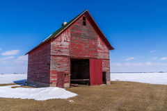 The red barn in the field. Royalty Free Stock Images