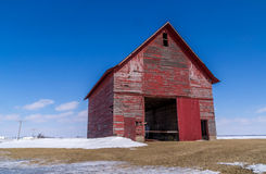 The red barn in the field. Stock Image
