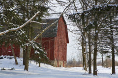 Red Barn. Framed by the snow-covered fields of Western New York stock photography