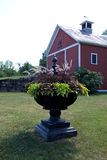 Red Barn Front with Plant Arrangement Stock Photos