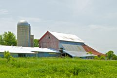 Red Barn and Green Meadow Royalty Free Stock Photography