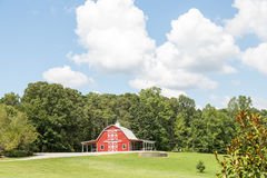 Red Barn and Green Trees Stock Images