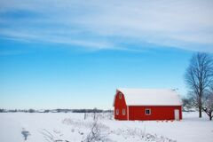 Red Barn House in the Middle of Snow Field During Daytime Royalty Free Stock Photo