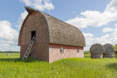 Red barn. With a ladder in front Stock Image