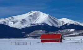 Red Barn and Mountain Range Outside Breckenridge,. Colorado royalty free stock photo