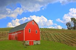 Red Barn in the Ohio Countryside. A red barn in Ohio farmland under a beautiful blue sky with cumulus clouds stock photos