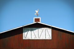 Red Barn. Old-fashioned American farm red barn with a rooster weather vane on top Royalty Free Stock Photography