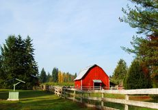 Red Barn and old fence. Red Barn on wooded acre in the country Stock Image