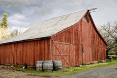 Red Barn. Old Red Barn, with wine barrels in front, California wine country Royalty Free Stock Image