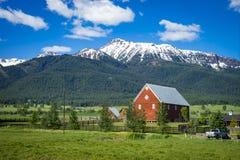 Red barn in Oregon. Red barn near Wallowa Mountains in Oregon Stock Image