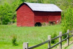 Red Barn In A Pasture Stock Photo